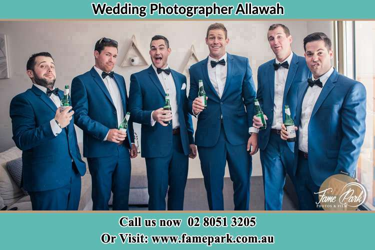 The groom and his groomsmen striking a wacky pose in front of the camera Allawah NSW 2218