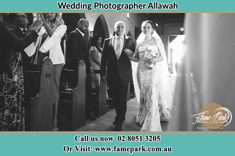 Photo of the Bride and her father walking the aisle Allawah NSW 2218