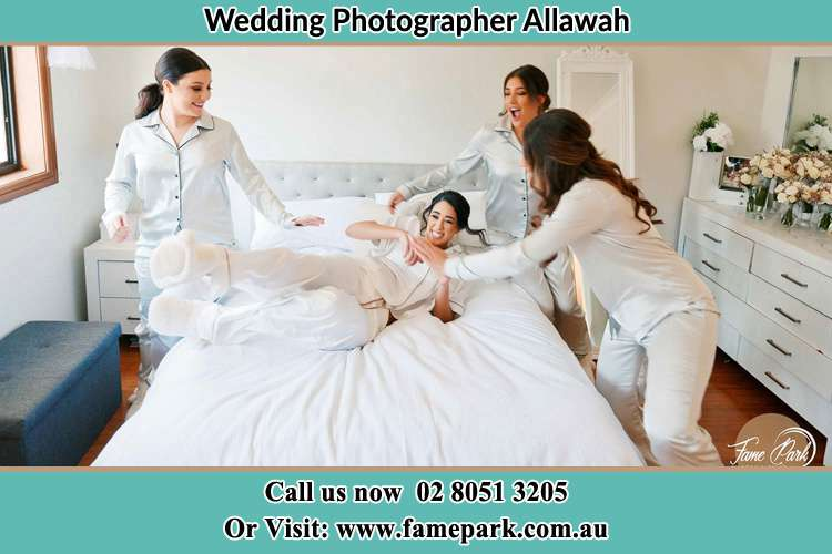 Photo of the Bride and the bridesmaids playing on the bed Allawah NSW 2218