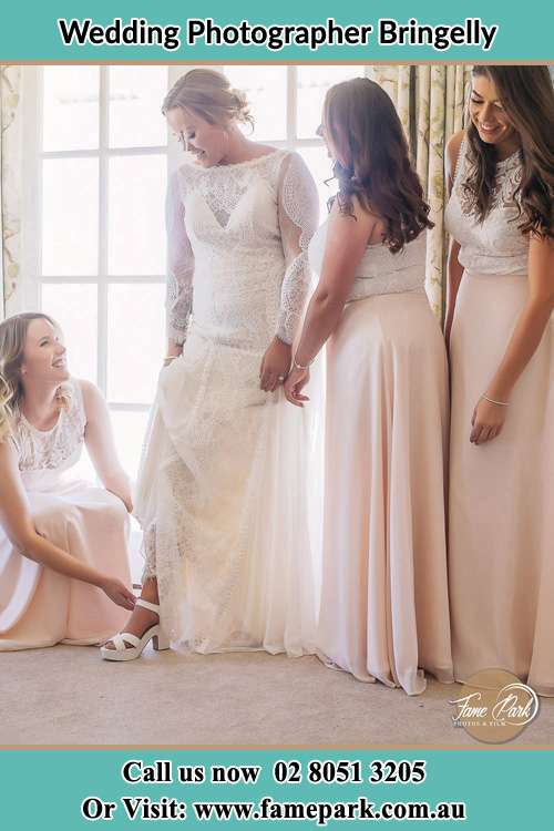 Photo of the Bride assisting by her bridesmaids Bringelly NSW 2556