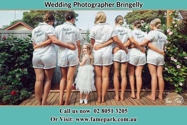 Behind photo of the Bride and the bridesmaids with the flower girl looking back on camera Bringelly NSW 2556