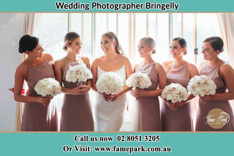 Photo of the Bride and the bridesmaids holding flower bouquet Bringelly NSW 2556