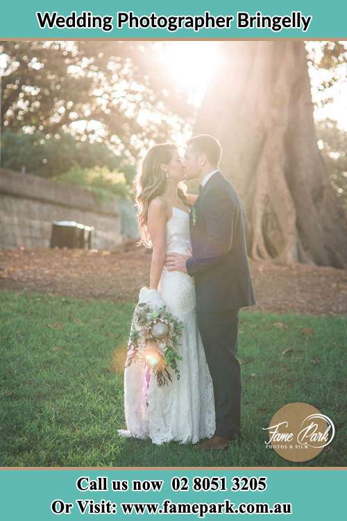 Photo of the Bride and the Groom kissing at the yard Bringelly NSW 2556