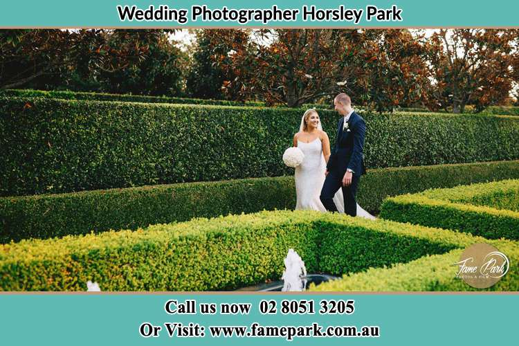 Photo of the Bride and the Groom walking at the garden Horsley Park NSW 2175