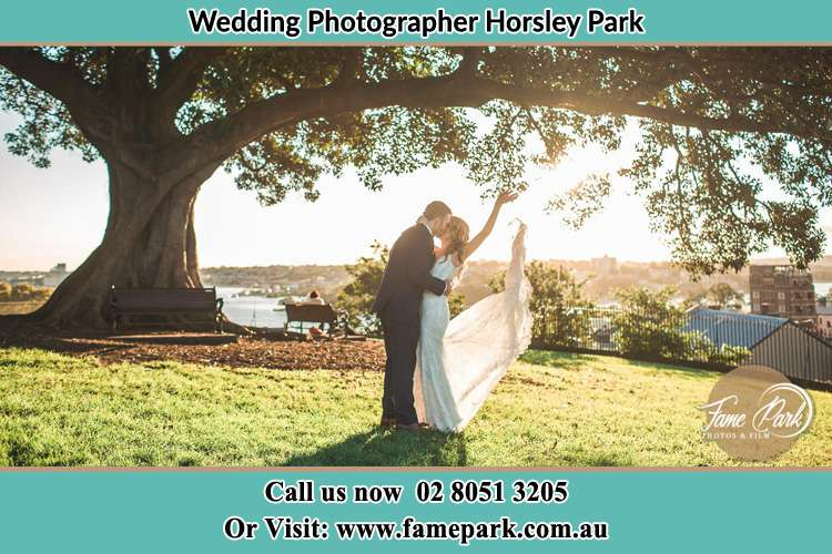 Photo of the Groom and the Bride kissing under the tree Horsley Park NSW 2175