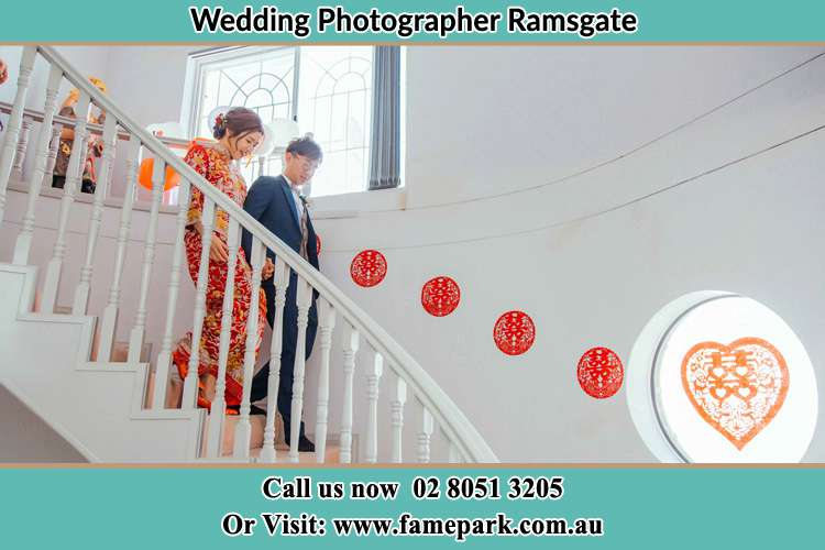 Photo of the Bride and the Groom going down the stair Ramsgate NSW 2217